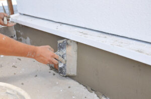 A stucco being repaired by a stucco contractor in Windsor, ON