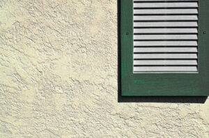 A stucco installed on the exterior of a house near the window in Windsor, ON
